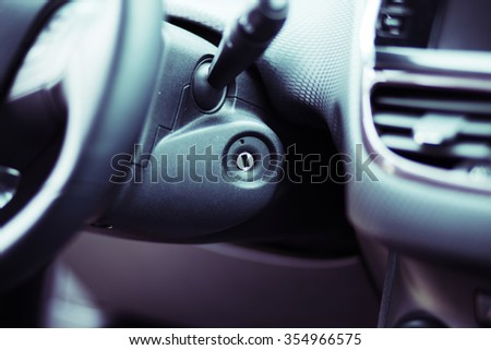 photo of Close up shot of the ignition keyhole in a car