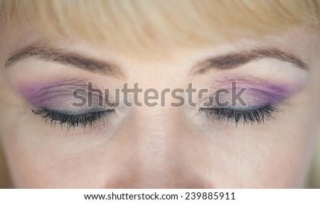Photo of closed eyes, a beautiful professional make-up, - stock photo