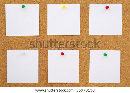 photo of closeup of note papers on cork board - stock photo