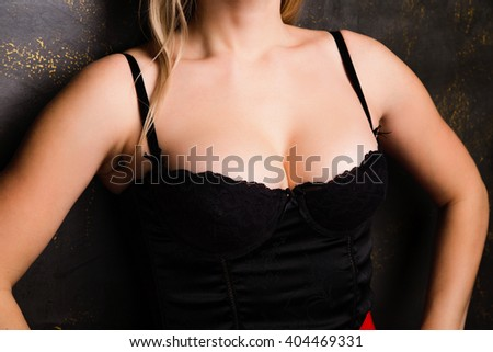 photo of Closeup photo of sexy woman with big breasts in corset