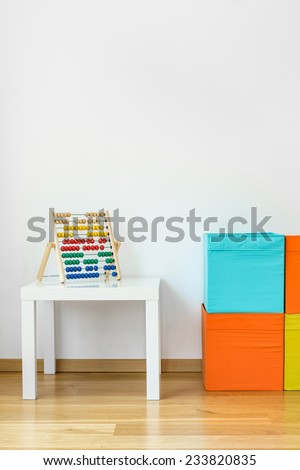 Photo of colorful children's toys in room - stock photo