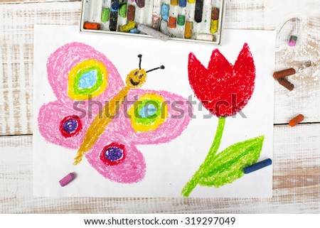photo of colorful drawing: happy butterfly and beautiful tulip - stock photo