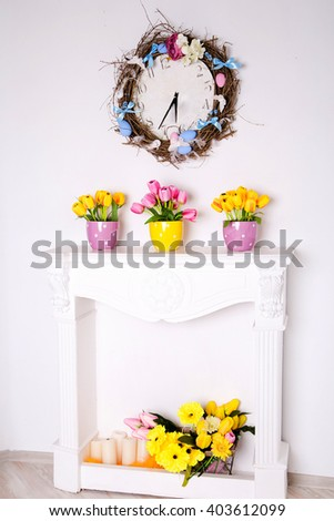 photo of colorful tulip flowers in colourful pots - stock photo