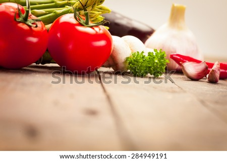 Photo of colorful vegetables over old wooden table - stock photo