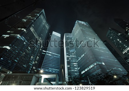 Photo of commercial office buildings exterior. Night view at bottom skyscrapers. - stock photo