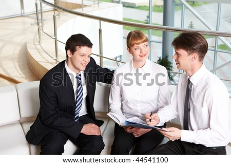 Photo of company of successful people planning work in office