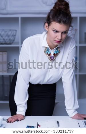 Photo of confident and attractive female working in corporation - stock photo