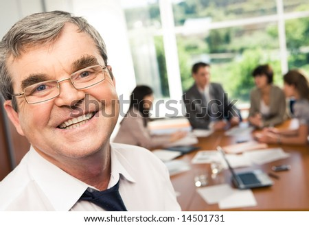Photo of confident businessman with smile during a conference - stock photo
