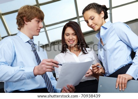 Photo of confident employees discussing at meeting