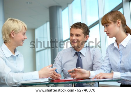 Photo of confident employees working in office - stock photo