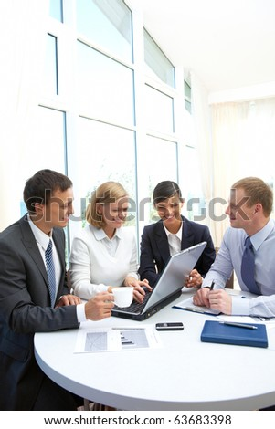 Photo of confident partners interacting at meeting in office - stock photo