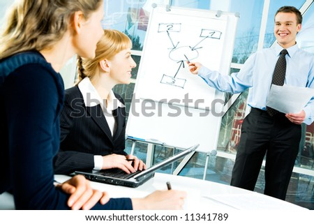 Photo of confident speaker giving a presentation at business meeting - stock photo