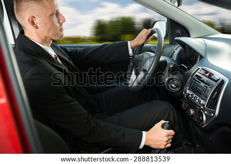Photo Of Confident Young Businessman Driving His Car