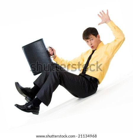 Photo of confused man sliding down during financial crisis