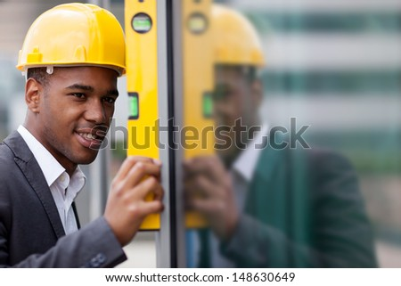 photo of construction engineer working with level - stock photo