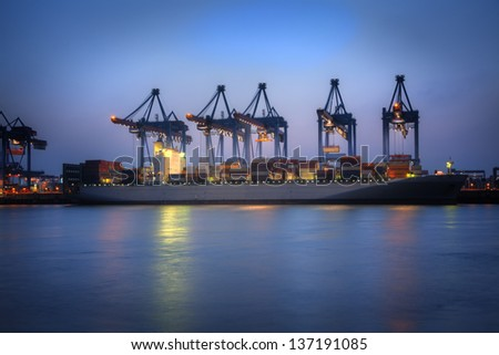 Photo of Container Ships in the harbor of Hamburg, Germany. - stock photo