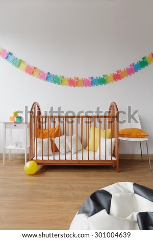 Photo of contemporary design spacious baby room with simple bed