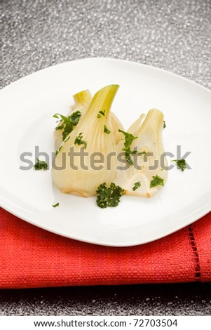 photo of cooked fennel with parley on a glass table