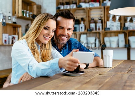 Photo of Couple taking selfie at cafe - stock photo