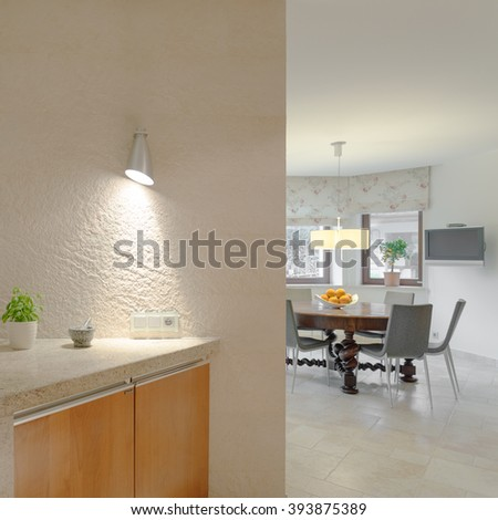 Photo of creamy modern kitchen equipped with professional devices - stock photo