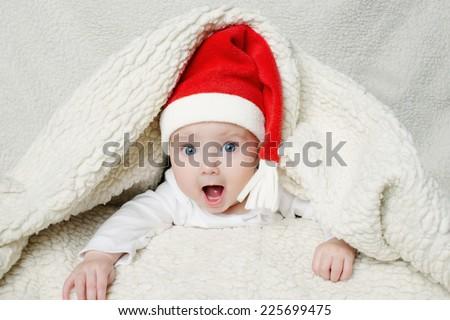 photo of cute baby in Santa hat - stock photo