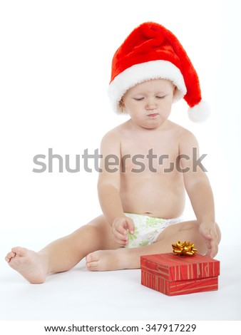 photo of cute boy with santa hat on white