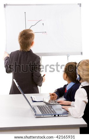 Photo of cute children looking at whiteboard during presentation - stock photo