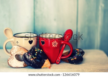 Photo of cute coffee cups with heart-shaped cookies - stock photo