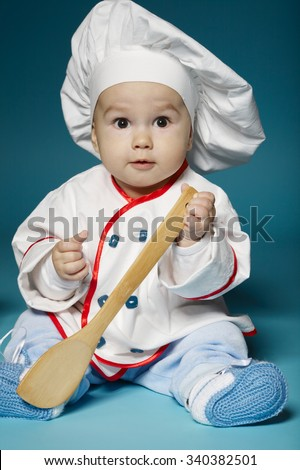 photo of cute little baby with chef hat