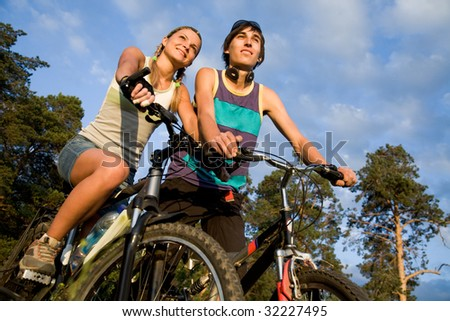 Photo of cyclists on their bikes in park or forest during summer vacations - stock photo