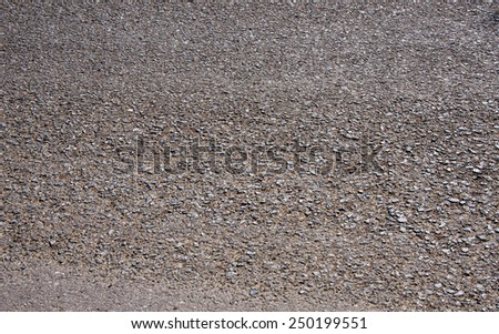 Photo of dark asphalted surface background - stock photo