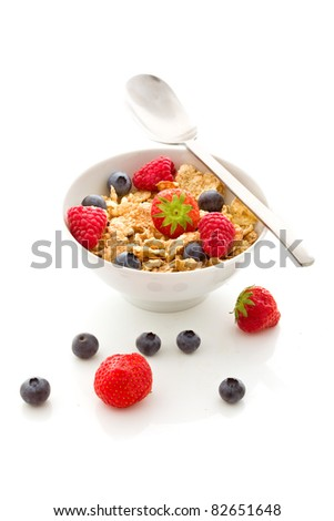 photo of delicious breakfast made of corn flakes with berries and fresh milk - stock photo
