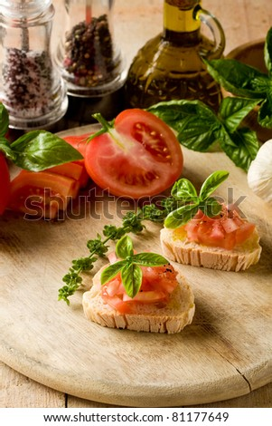 photo of delicious bruschetta with tomatoes on wooden table - stock photo