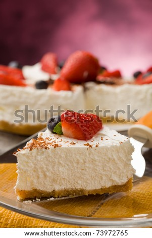 photo of delicious cake with strawberries on wooden table - stock photo