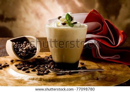 photo of delicious coffee beverage with whipped cream and coffee beans - stock photo