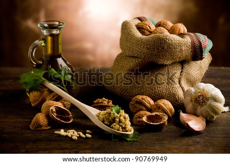 photo of delicious fresh ingredients for walnut pesto on wooden table - stock photo