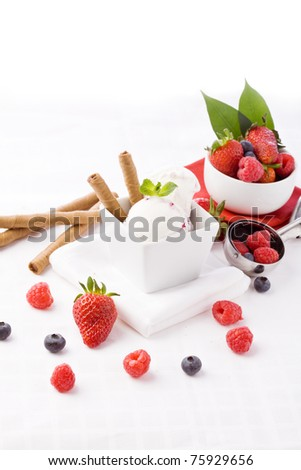 photo of delicious ice cream with berries on the table - stock photo