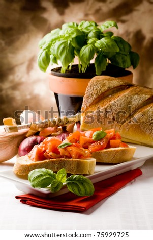 photo of delicious italian bruschetta with basil and ingredients - stock photo
