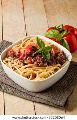 photo of delicious italian pasta with meat sauce on wooden table