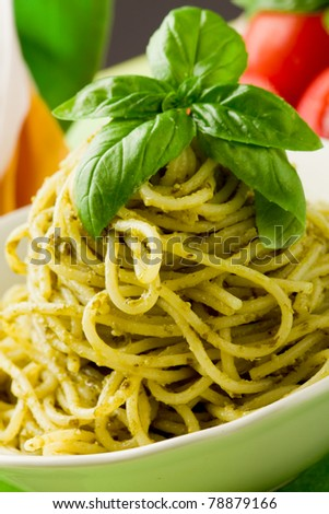 photo of delicious italian pasta with pesto sauce - stock photo
