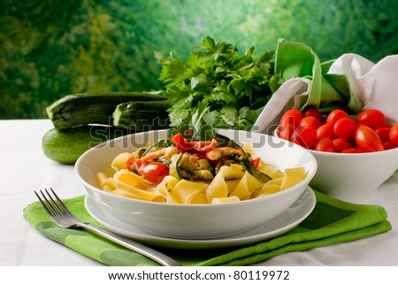 photo of delicious italian pasta with zucchini and shrimps - stock photo