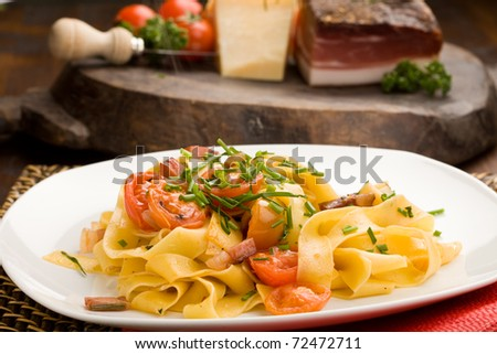 photo of delicious pasta with bacon and tomatoes - stock photo