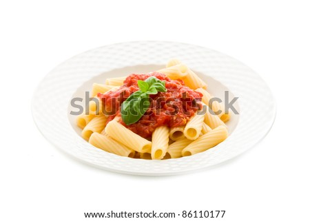photo of delicious pasta with basil and tomato sauce on white background - stock photo