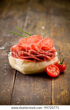 photo of delicious salami sandwich on wooden table - stock photo