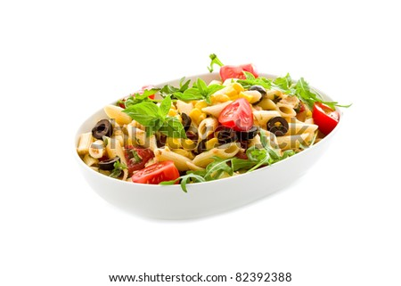 photo of delicious tasty pasta salad with fresh vegetables on isolated background - stock photo