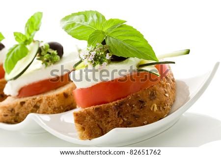 photo of delicious tomato mozzarella starter isolated white background - stock photo