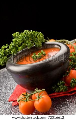 photo of delicious tomatoe sauce with parsley on red cloth