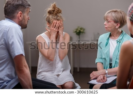 Photo of depressed female during session of support group - stock photo