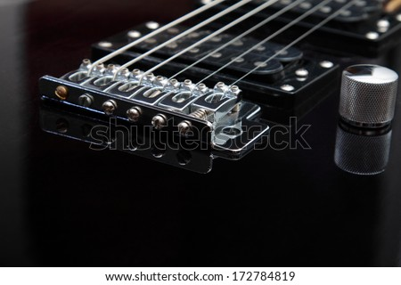 Photo of details of an electric guitar close up - stock photo
