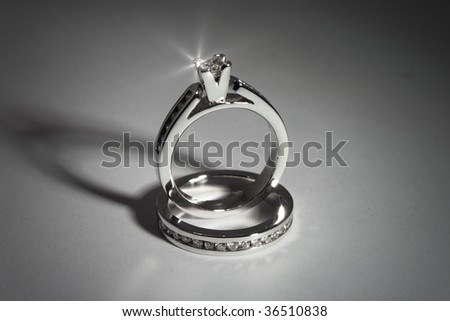 photo of diamond solitaire ring and channel set, princess cut - stock photo
